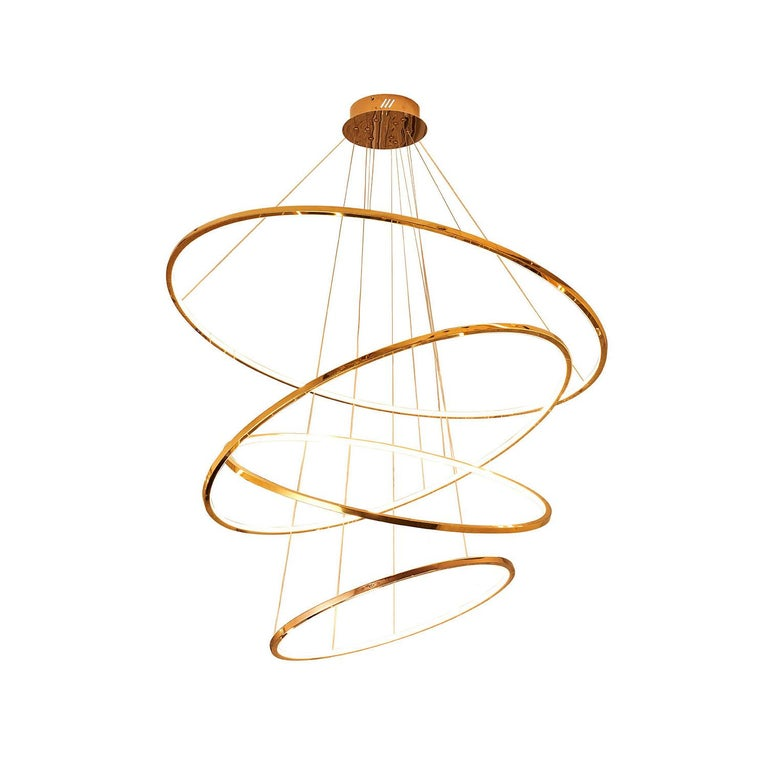 Individual rings with integrated LED stripes grouped together. The height and tilt of each ring can be adjusted individually. 3000K 110 lumen / watt  Finishes:  Rose gold, polished or brushed Champagne gold, polished or brushed Gold,