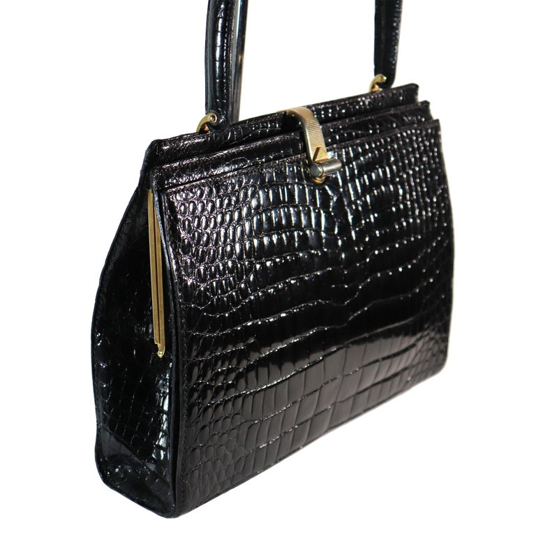 Lederer Black Alligator Purse W/ Gold Hardware & Expandable Frame. In Excellent condition   Very Rare and Stylish handbag   Measurements:   Height - 8.5 Inches  Width - 11 Inches  Height - Strap - 14.5 Inches