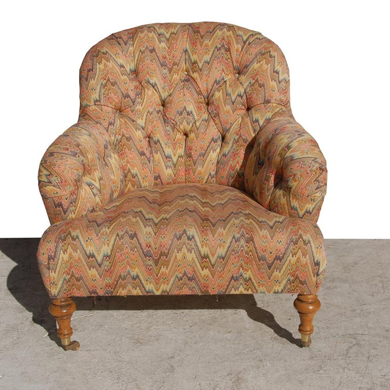 Caprice chair with matching ottoman by Lee Jofa. Chair has brass casters along with the ottoman as well.  Reupholstery recommended.