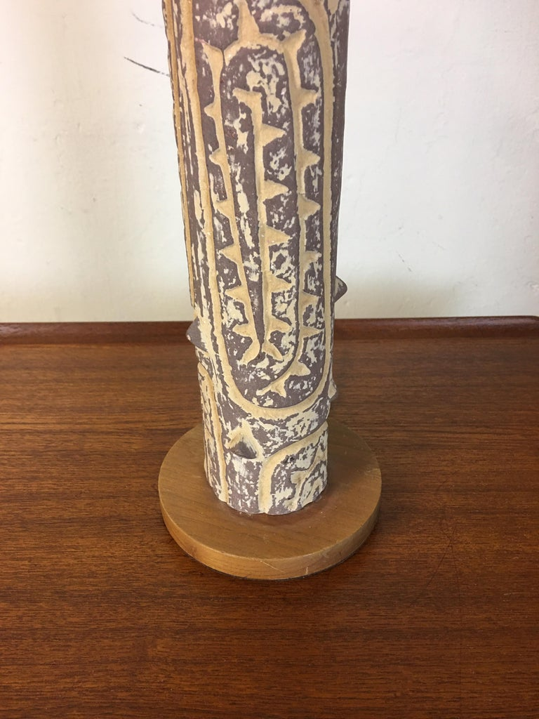 Lee Rosen for Design technics incised tree like ceramic table lamp. I have seen lamps with this patterned column in differing heights. Many models were made of the tubes. Ceramic body sits on a simple wood base. Body of lamp with wood base measures: