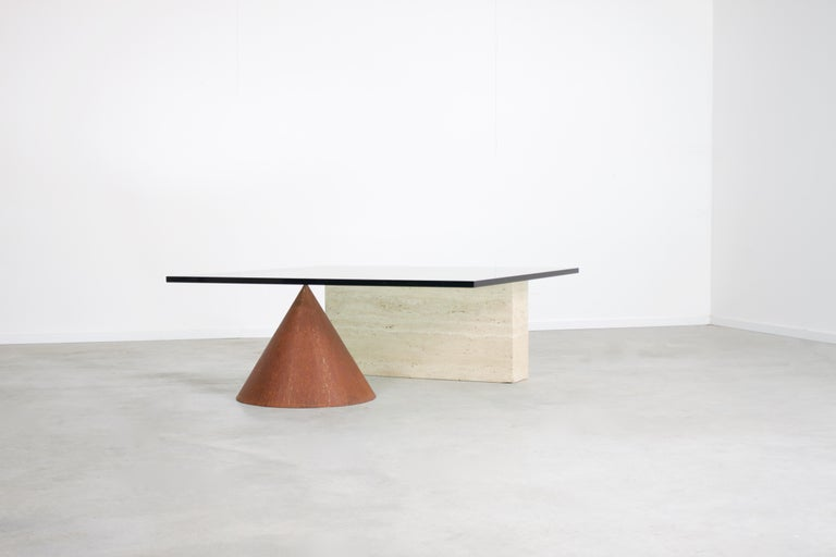 Sculptural Kono coffee table in very good condition.  Designed by Lella & Massimo Vignelli in the 1970s   Manufactured by Casigliani, Italy  The Kono table consists of a combination of materials and forms.  The thick glass top is resting on a cone