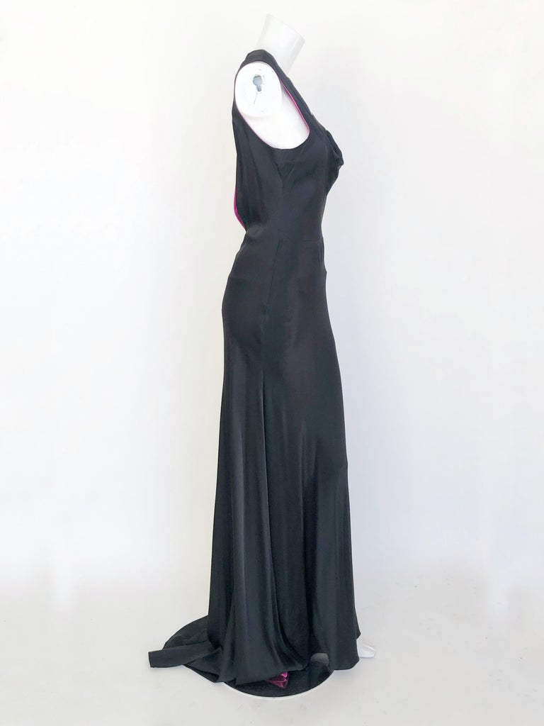 1940'S inspired bias cut gown with fuchsia lining, key hole back, covered buttons on the side.
