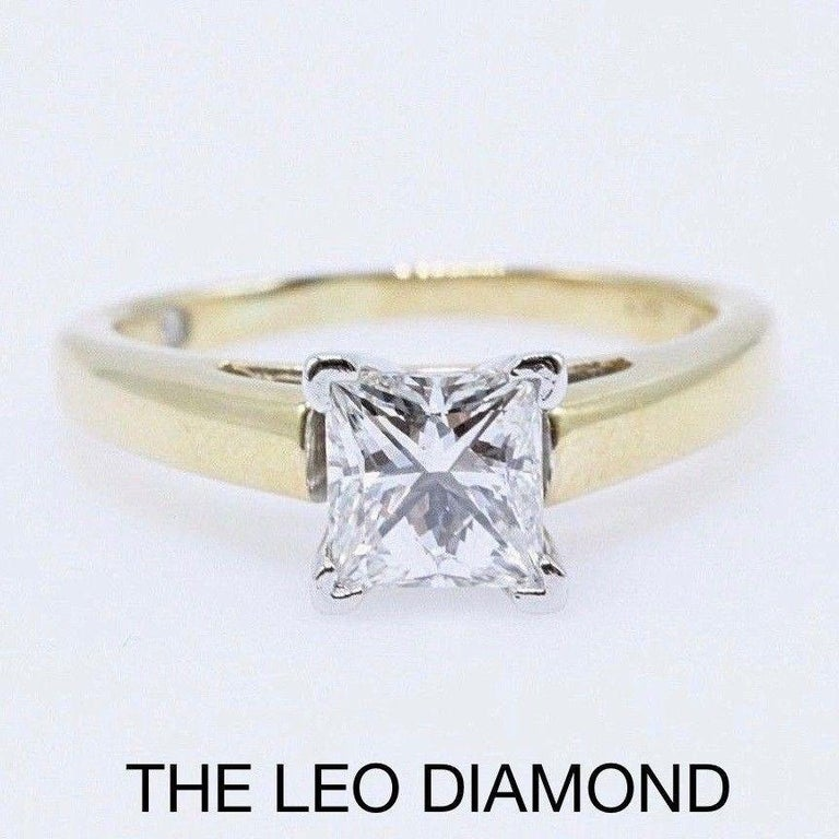 The Leo Diamond Style: Solitaire  Serial Number: LEO-27617S Metal: 14KT Yellow Gold & Platinum  Total Carat Weight: 0.97 CTS Diamond Shape: Square Modified Brilliant  Diamond Color & Clarity: I / SI1  Size:  6.75 ( Sizable ) Includes: -Diamond