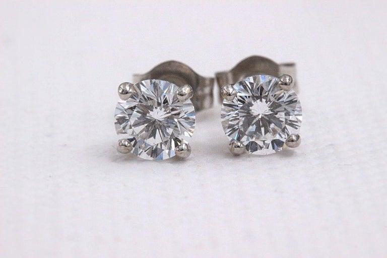 Leo Diamond Stud Earrings Rounds 0.98 Carat F-G SI 14 Karat White Gold For Sale 7