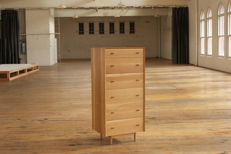 American Leo Highboy, Modern Tall Chest of Drawers with Turned Legs and Shaped Pulls For Sale