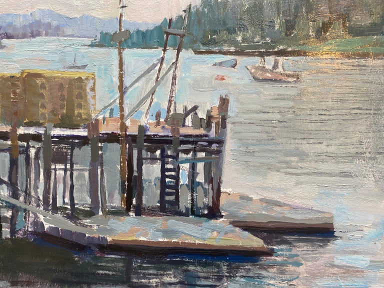 Painted en plein air, in the style of contemporary impressionism. An old dock jutts out from shore, into the body of water. A single blue structure floats atop the edge of the dock. Stacks of boxes, or lobster traps sit atop.Boats float in the
