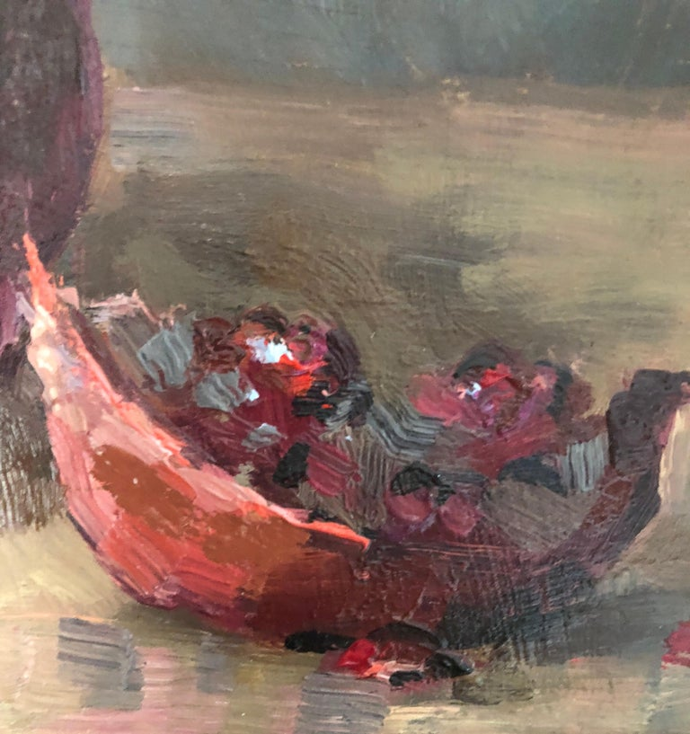 This small, beautifully framed oil painting of a pomegranate is bursting with vibrancy and light. Leo Mancini-Hresko is a prolific artist who creates painterly, dynamic work with bold, rich use of medium and effects of light and shade. In the