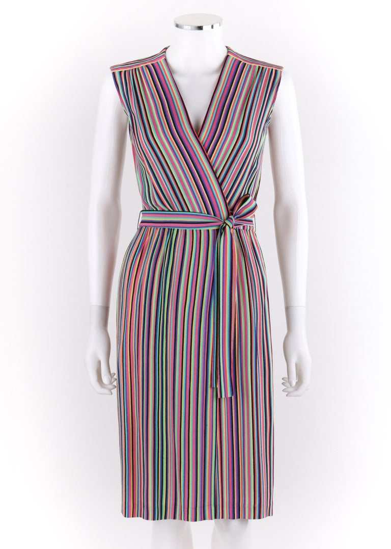 LEO NARDUCCI c.1970's Multi-Color Rainbow Vertical Stripe Wrap Dress   Circa: 1970's Label(s): Narducci / Int. ILGWU  Int. Ladies Garment Worker Union   Style: Wrap dress Color(s): Shades of black, pink, yellow, green, magenta and purple.  Lined: