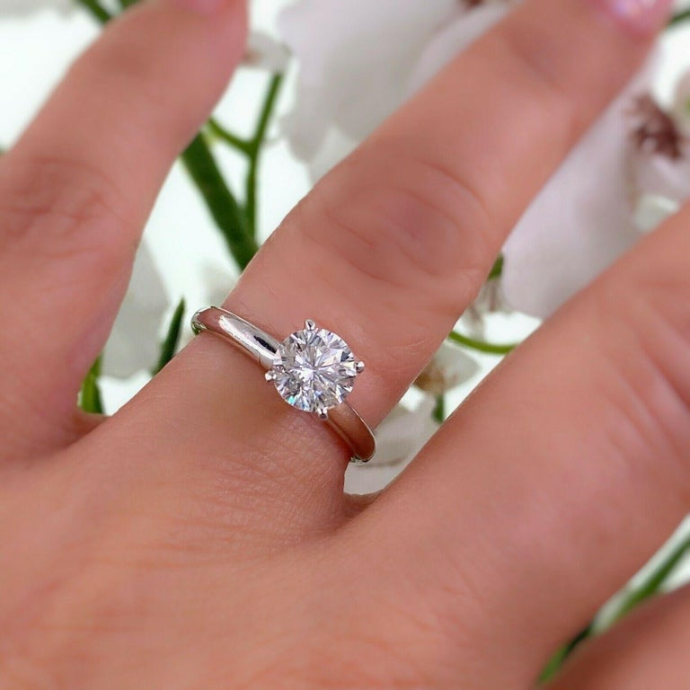 Leo Diamond Engagement Ring Style:  4 - Prong Solitaire Certification:  IGI 7092060A Metal:  18kt Whit Gold Ring with Platinum Prongs Size / Measurements:  5 - sizable TCW:  1.01 cts Main Diamond:  Round Modified Brilliant Color & Clarity:  G -