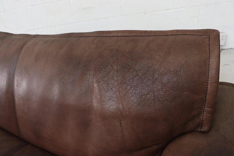 Well worn Leolux Buffalo Leather Love Seat For Sale 5