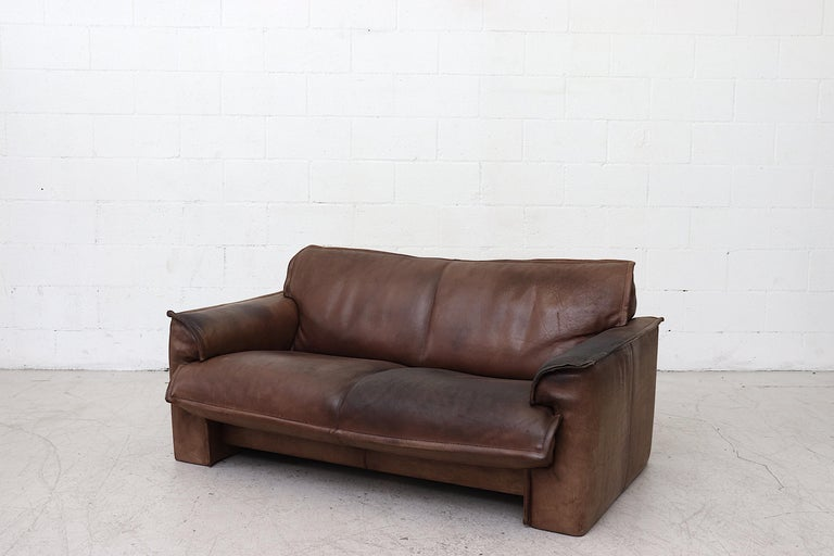 Mid-Century Modern Well worn Leolux Buffalo Leather Love Seat For Sale