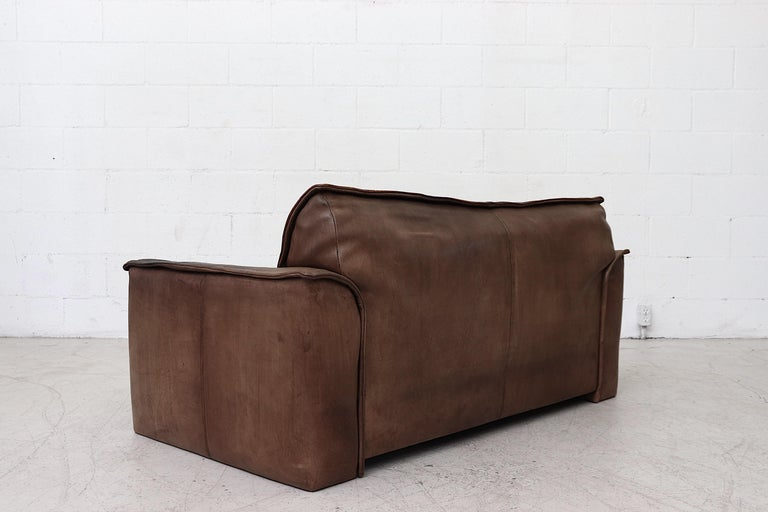 Well worn Leolux Buffalo Leather Love Seat In Good Condition For Sale In Los Angeles, CA
