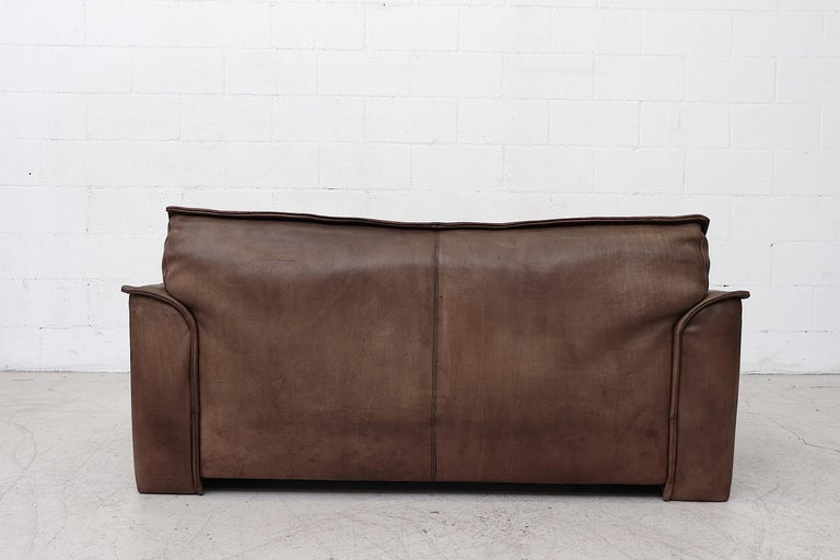 Late 20th Century Well worn Leolux Buffalo Leather Love Seat For Sale