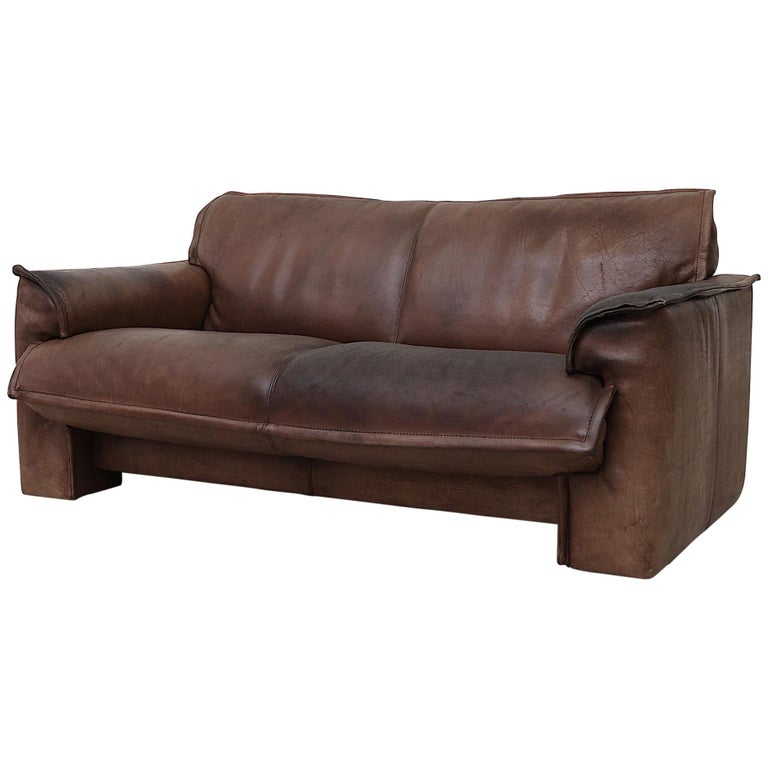 Well worn Leolux Buffalo Leather Love Seat For Sale