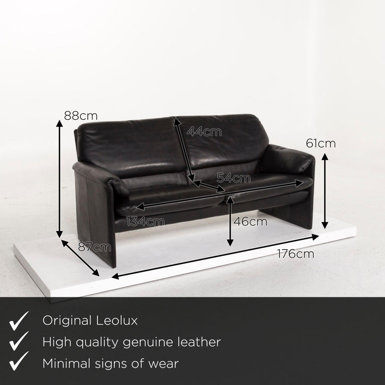 We present to you a Leolux leather sofa black two-seat couch.     Product measurements in centimeters:    Depth 87 Width 176 Height 88 Seat height 46 Rest height 61 Seat depth 54 Seat width 134 Back height 44.