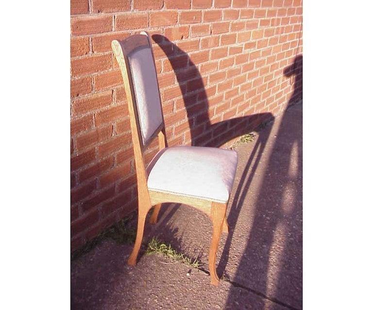 Leon Benouville. An Art Nouveau oak desk or side chair with subtle organic lines.