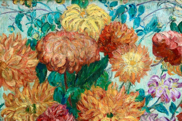 A beautifully coloured and painted oil on canvas by French post impressionist painter Leon Detroy depicting a vase of dahlias in yellows, oranges, reds and purples. Signed lower centre right.  Dimensions: Framed: 43