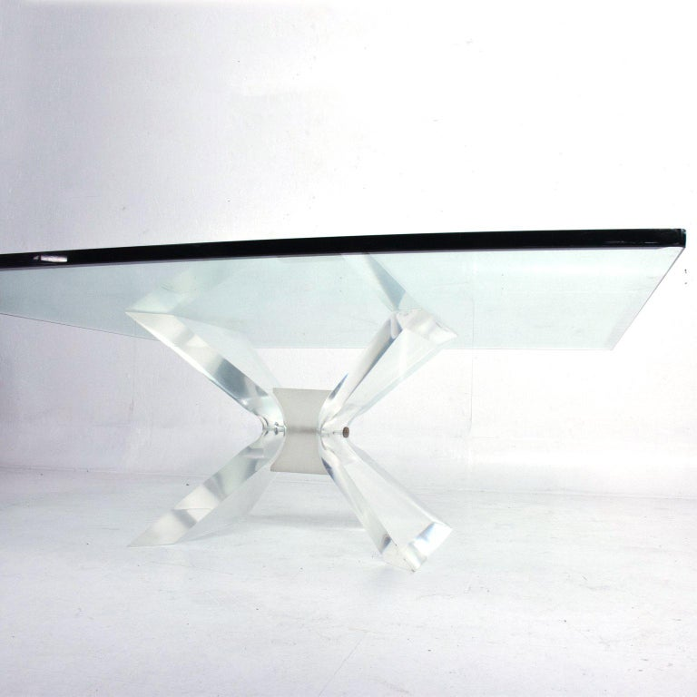 For your consideration a coffee table by Leon Frost. Sculptural coffee table base with a square glass top.   41 3/4