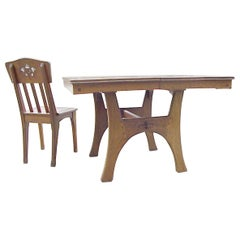 Leon Jallot a French Arts & Crafts Oak Extending Dining Table with Six Chairs