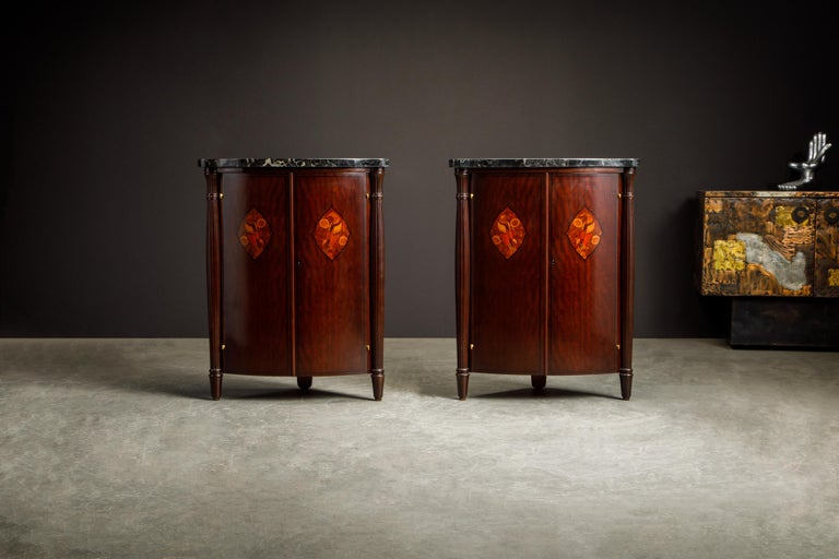 An incredible and important pair of Art Deco marquetry encoignures (corner cabinets) by famed French Art Deco designer and maker Leon Jallot, circa 1920s Paris, France. We just completed restoration to both cabinets in a gorgeous French Polish which