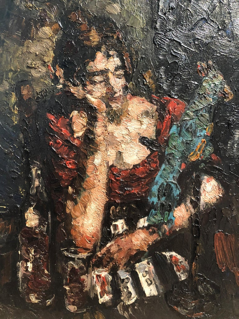 Leon Kelly (American, 1901 - 1982) The Fortune Teller (Woman with Playing Cards, a Bottle of Wine, and a Parrot), circa 1926 Oil on canvasboard 20 x 16 inches Signed lower right Housed in a distressed wooden frame  Leon Kelly is admired as one of