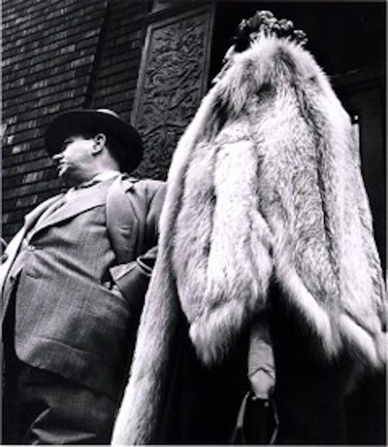 Man in Suit, Woman in Fur Coat
