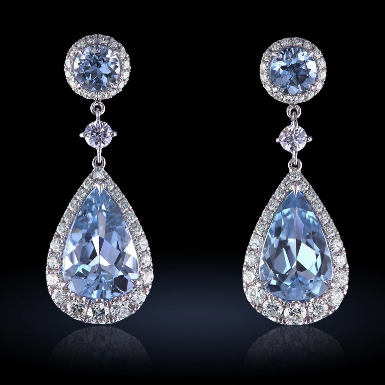 Wedding special - custom made drop earrings featuring natural aquamarines and finest diamonds set in platinum. The earrings are simple and sophisticated with fully detachable aquamarine pendents. Simply slide the attachment off to remove it and wear