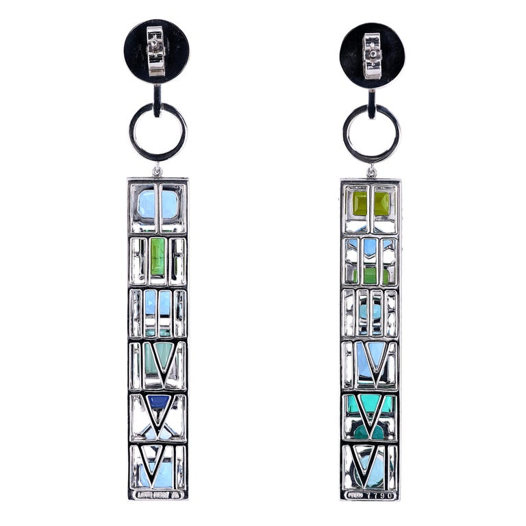 One-of-a-kind platinum earrings set with a total of 15.55 carats of natural gemstones - tourmaline, aquamarine, and sapphire. Hinged, 10 mm post with butterfly-style self-locking pushbacks. The frame has micro pave detail combining 222 full-cut