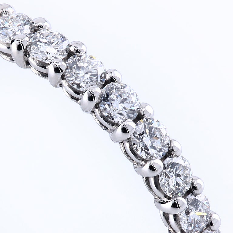 """The """"Grace"""" platinum eternity band is set with perfectly matched ideal cut F/VS round 2.0 mm diamonds held in place by shared prongs. The amount of sparkle the ring flashes is simply staggering. 28 stones 0.96 carats total weight Finger size 5 3/4"""