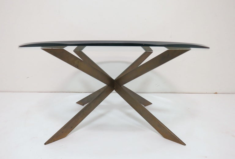 Coffee table by Leon Rosen for Pace with a bronze double X-form / starburst base and original beveled glass top, circa 1970s.