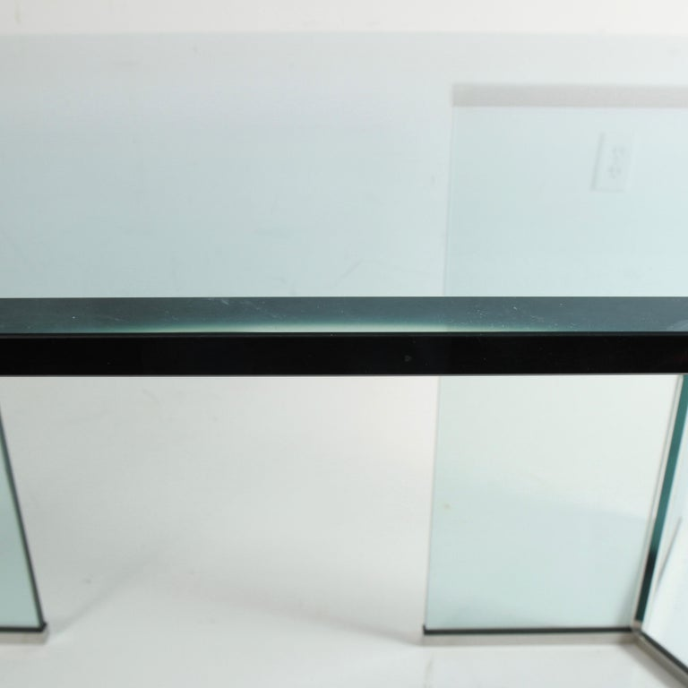 An iconic 1970s era dining table designed by Leon Rosen for Pace Collection. It's made entirely from glass and chrome, the glass on the base is extremely thick and heavy. It's in very good overall condition, the 5/8