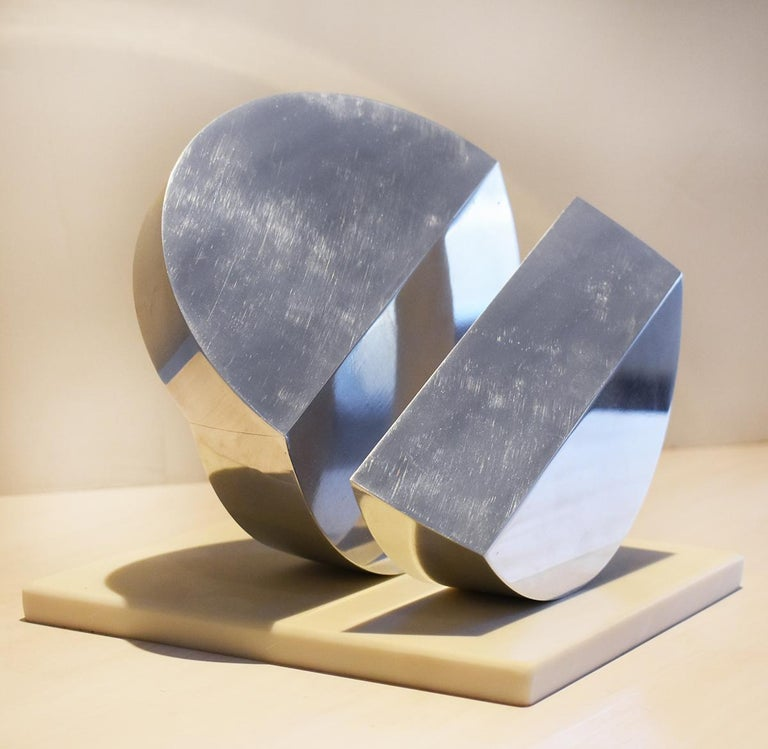 Small abstract, minimalist mid century modern style sculpture  Silver colored polished stainless steel and marble base 7 x 6 x 6 inches Marble base measures 7 x 7 inches Sculpture weighs about 15 lbs.   This small, contemporary abstract silver