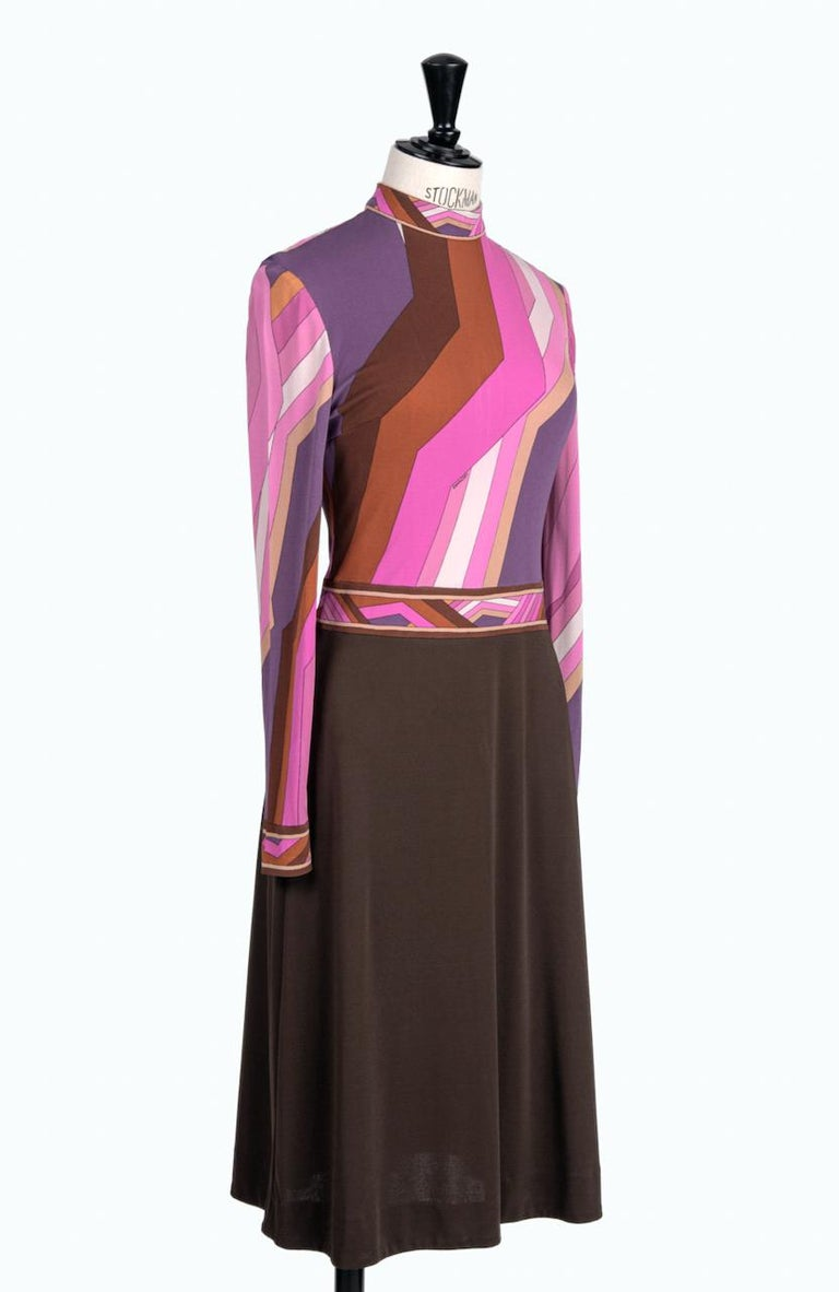 This is a stunning 1970s Leonard Fashion Paris jersey dress with one of their iconic vibrant geometric prints covering the top.  The dress has a fitted cut through bodice with a natural waistline and long, slim sleeves. It is made of the finest pure