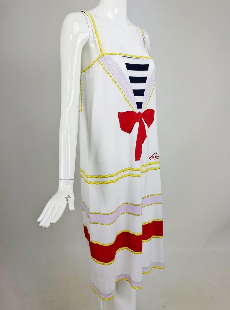 Leonard Paris novelty printed cotton knit sun dress from the 1980s. Soft white cotton knit sun dress is brightly printed with a nautical theme sailor dress and rope print detailing. The dress pulls on, there is cased elastic at the bodice top edge,
