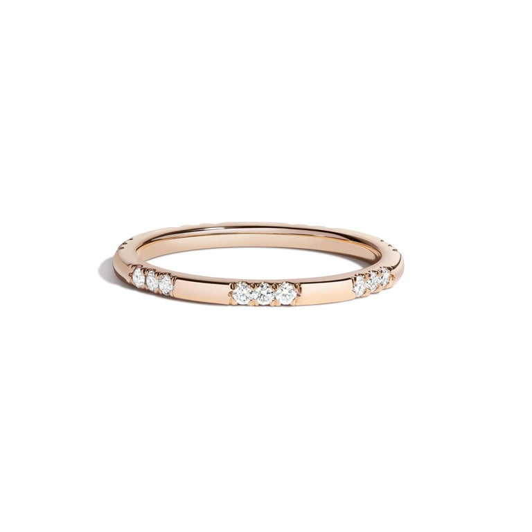 Gold and white diamonds don't compete for attention, they both take center stage in our Leonie Ring. An instant classic and most welcome addition to the collection!   14k yellow gold White diamond carat weight: 0.25c 1.65mm band width Available in