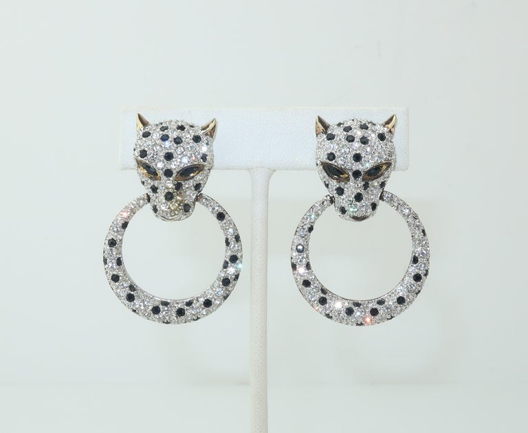 These C.1980 clip on earrings are fabricated from gilt sterling silver and feature leopards embellished with sparkling crystal clear and black rhinestones suspending articulated door knocker rings.  'Purrrrfect' for adding a glamorous touch to your