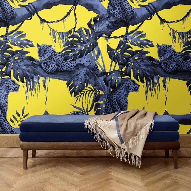 In this stunning wall covering, a leopard majestically sits under the shade of a jungle tree. Displaying a unique color combination and refined artistry in depicting these naturalistic elements, this impactful decoration will not go unnoticed. It is