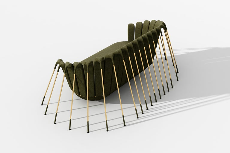 The Araigneé sofa? has an upholstered seat in olive green velvet, placed on a rounded base and suspended by a multitude of gold metal legs.  While Marc Ange's most iconic creation Le Refuge proposed an island of safety and comfort, Les Les Araigneés
