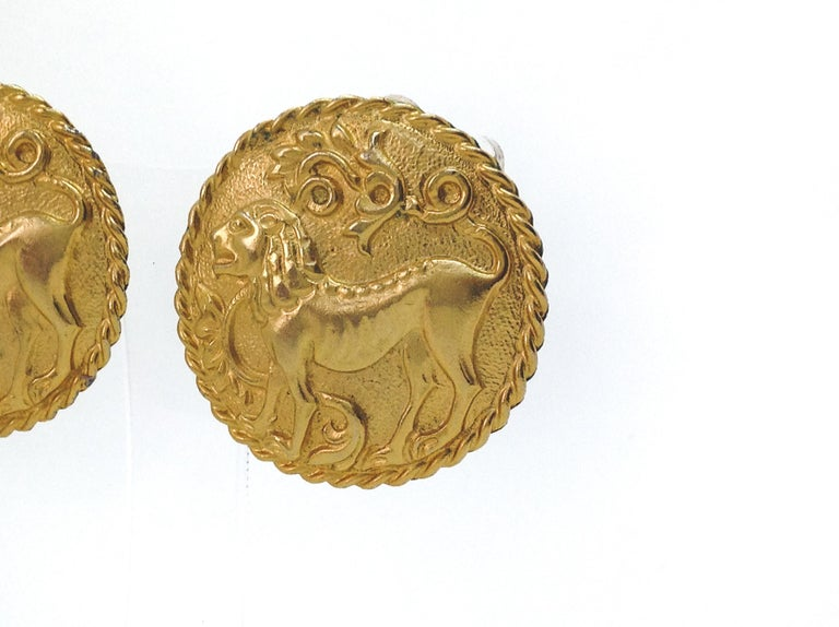 Les Bernard 1980s Vintage Clip on Earrings  Fantastic statement earrings from Les Bernard, the designer of jewellery for Alexis Carrington herself! These are iconic earrings of the era. Bold Roman style medallions embossed with lions.  For power