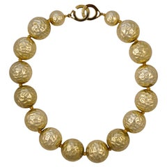 Les Bernard Pale Gold Tone Textured Leaves Ball Bead Statement Necklace