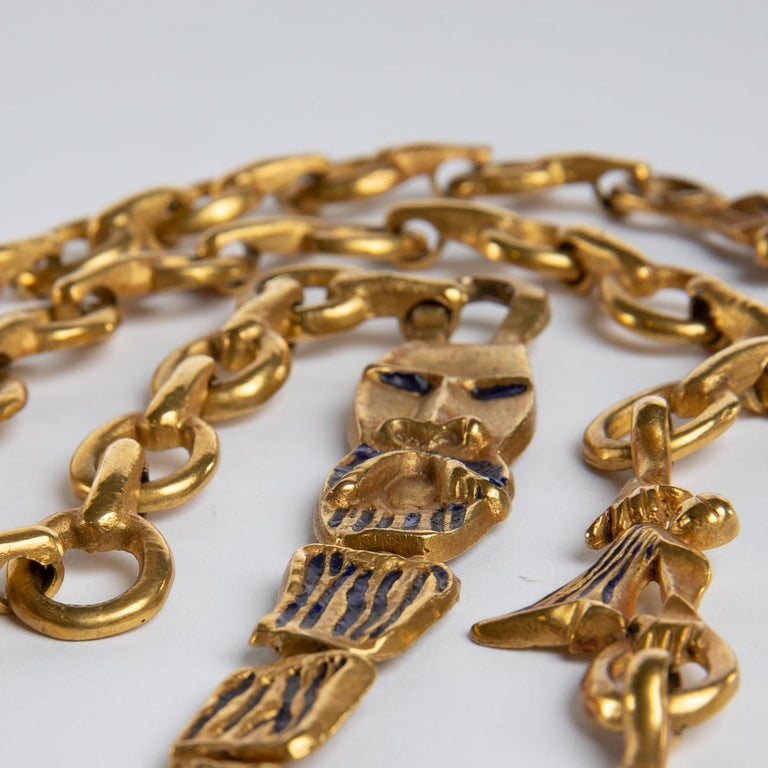"""This gilded bronze chain was imagined by Line Vautrin. It represents the """"Bluebeard"""" French folktale written by Charles Perrault and published in Paris in 1967.  Barbe Bleue is on the right side of the necklace and his six wives are on the left."""