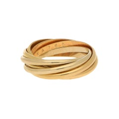 Les Must de Cartier Seven Band Trinity Ring 18 Karat Tri-Gold
