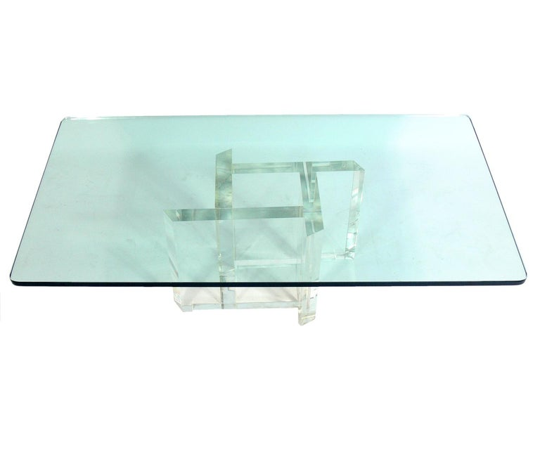 Les Prismatiques Lucite and glass coffee table, American, circa 1970s. Signed Les Prismatiques on base. It is well constructed with a chunky Lucite or acrylic base and a thick rectangular glass top.