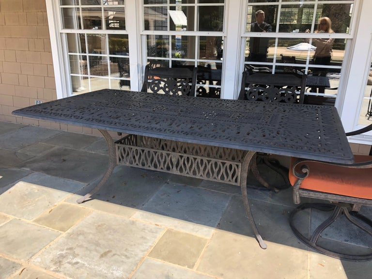Let's Have a Party Large Cast Aluminum Patio Dining Table and 6 Armchairs For Sale 4