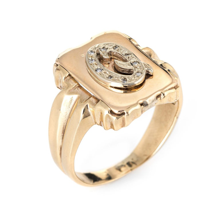 Stylish vintage letter Q initial diamond signet ring (circa 1960s to 1970s) crafted in 14 karat yellow gold.   Diamonds total an estimated 0.10 carats (estimated at I-J color and I1 clarity).   The square signet ring is crafted in a north-west