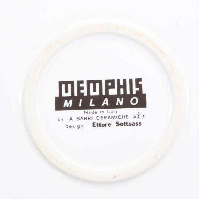 The Lettuce ceramic dinner plate was originally designed by Ettore Sottsass, in 1985, as part of a series of decorative plates. The playful names of the design items are a reminder of the fashion-like trends.  Ettore Sottsass was born in Innsbruck