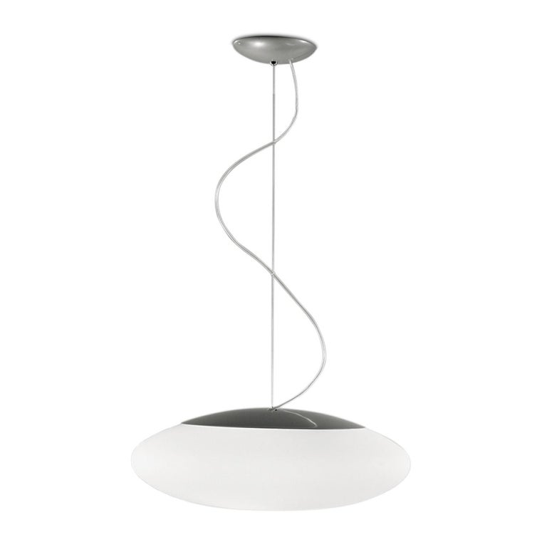 The Felix pendant was created by Leucos design lab by mixing a sphere with an ellipse. The result is a beautiful hand blown glass shape with soft curves and luminous volume. This hand blown diffuser is made of multiple layers of glass to create a