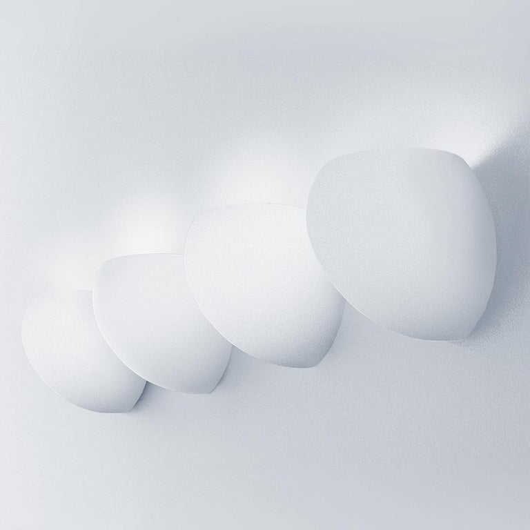 The Golf wall lamp is a whimsical, bestselling design from the historic Leucos design collection. Designed by Toso & Massari, the Golf Collection includes a versatile array of pendants, wall and ceiling lamps. Each comes with the option of a hand