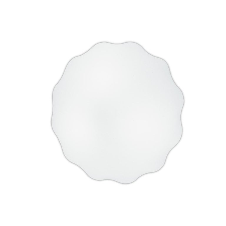 Nubia was designed by Toso, Massari & Associates in 1996 using clouds and shells as inspiration. The diffuser is a feat of craftsmanship with scalloped hand blown glass in three layers. Nubia makes use of a traditional Venetian glass blowing