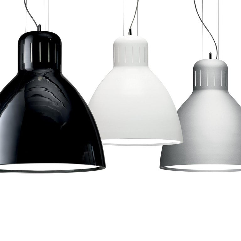 The Great JJ pendant updates the original Jac Jacobsen L-1 architect desk lamp (1937) for contemporary use. The 2006 refresh of this iconic design is a clever play on scale and light topology (creating a large-scale pendant from a small-scale task